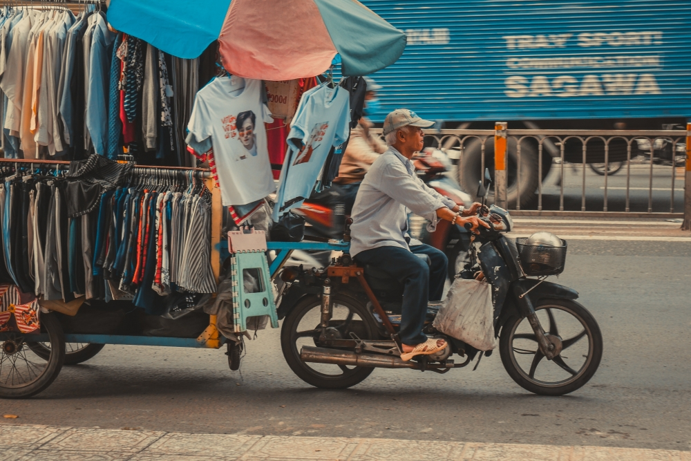 (PHOTOS) The Inventive Ways People Use Mopeds In This Southeast Asian Capital City